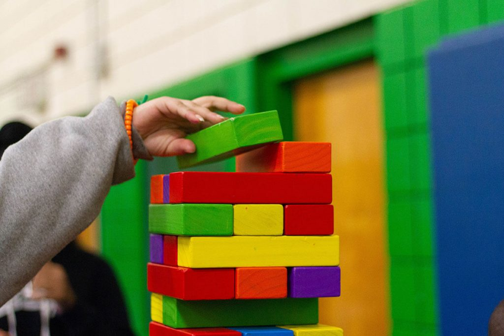 A child playing with blocks in a Montessori school